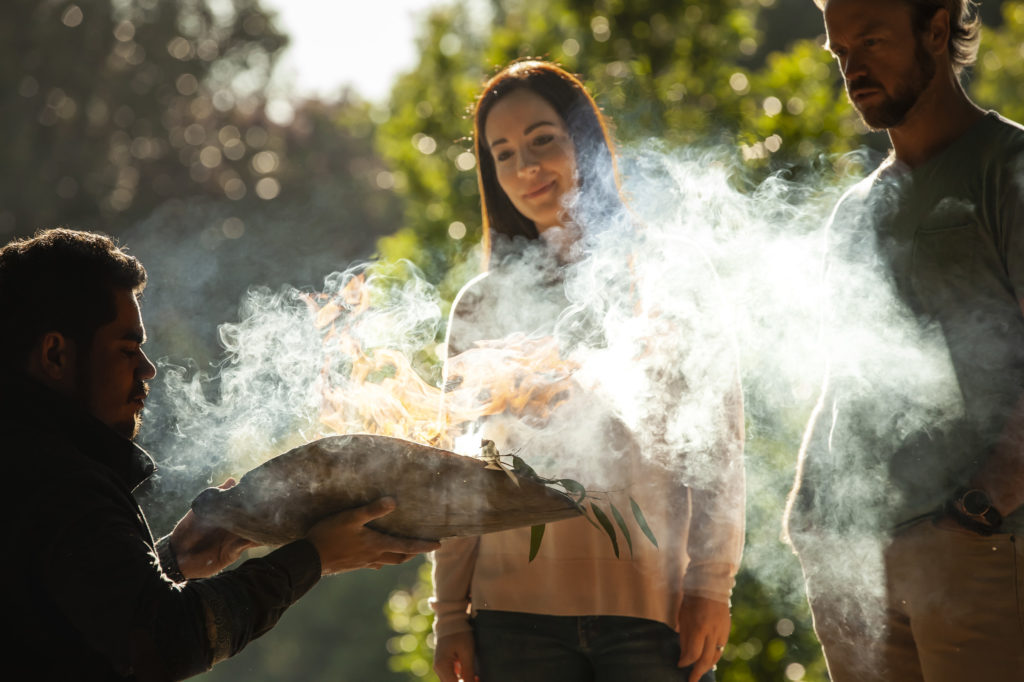 A traditional smoking ceremony welcomes visitors to the Aboriginal Heritage Walk at the Royal Botanic Gardens, one of the must-do Indigenous Melbourne experiences
